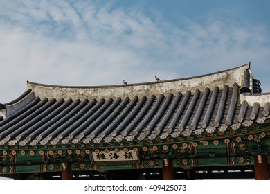 Korean Temple Roof Detail with Pigeons Near Jungang Market. Jeju, South Korea