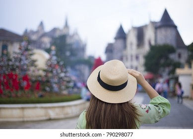 Korean tourist is traveling into French village in Danang, Vietnam.