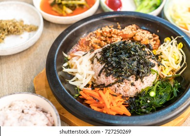 korean traditional food (Bibimbap) - Rice is topped with seasoned vegetables, meat and a sunny side up fried egg on top