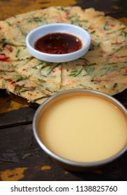 Korean traditional food, Gamjajeon and Makgeolli.