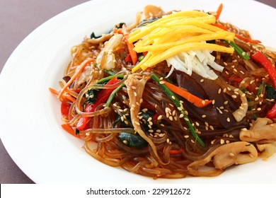 "Korean traditional food. Stir fried glass noodle with soy sauce called ""Japchae / Chapchae"""