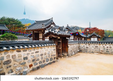 Korean traditional house and Namsan Seoul tower at autumn in Korea