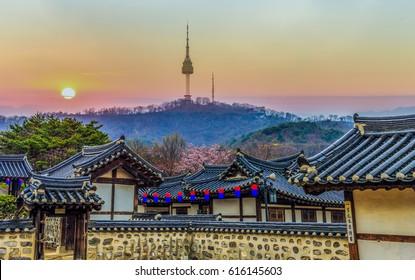 Korean traditional house. Namsangol Hanok Village and Seoul Tower background, Seoul, South Korea.