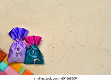 Korean traditional lucky bag and the background, Korean traditional paper texture and traditional textile pattern, Korean traditional texture