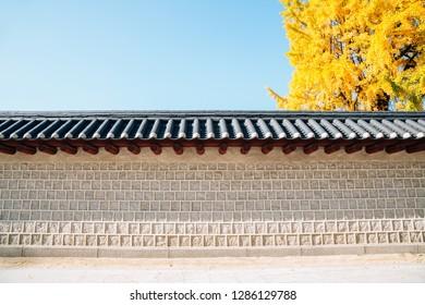 Korean traditional wall with autumn yellow ginkgo tree in Seoul, Korea