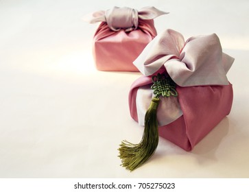 Korean traditional wrapping decorated with silk and pendant (selective focus)