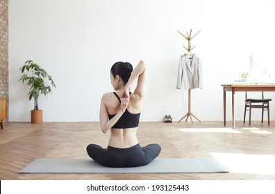 Korean woman doing yoga