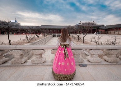 Korean woman dressed Hanbok,Korean traditional dress in Gyeongbokgung Palace, Seoul, South Korea.The wording of symbols 'Do not lean on' on a sign.