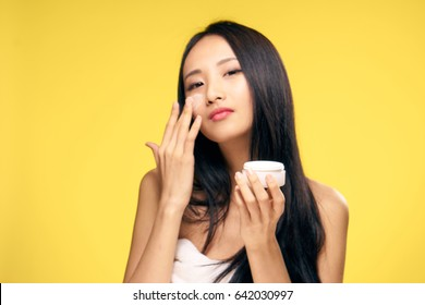 Korean woman with face cream