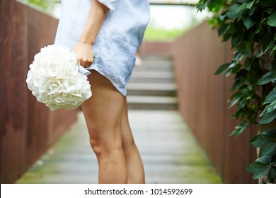 Korean woman holding flower bouquet