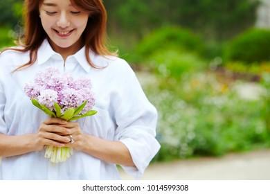 Korean woman holding flower bouquet