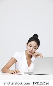 Korean woman working on laptop