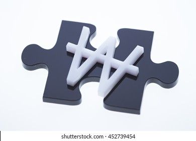 Korean won currency symbol with jigsaw puzzle piece