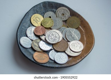 Korean won Japanese yen coins,  collectible coin,  empire, collectors, numismatic, metal money,  tokens collection of currency, on metal tray, on bazaar antique shop financal economy