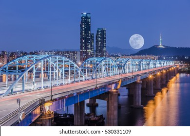 Korea,Seoul at night, South Korea city skyline at Dongjak Bridge Hangang river in Seoul , South Korea.  Background moon.