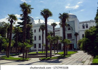 Koreiz, Crimea-9 June, 2016.The main building (facade) in the Palace of Dulber among palm trees. An object of cultural heritage of Federal significance. Sanatorium in summer on a clear Sunny day