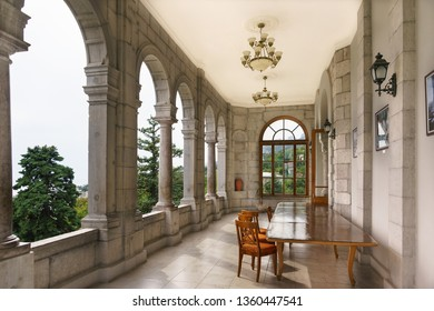 Koreiz, Yalta, Crimea, Russia - September 13, 2018: Open veranda of the southern facade of the Yusupov Palace. The balcony offers a beautiful view of the Park and the Black sea