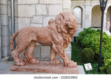 """Koreiz, Yalta, Crimea, Russia-September 13, 2018: Terracotta lion near the main entrance to the Yusupov Palace. The inscription in Russian """" it is forbidden to Touch the sculpture"""""""