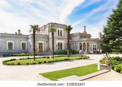 Koreiz, Yalta, Crimea, Russia-September 13, 2018: the Area of three palm trees at the entrance to the Palace of Prince Yusupov. Open for tourist visiting historical object on a Sunny summer day