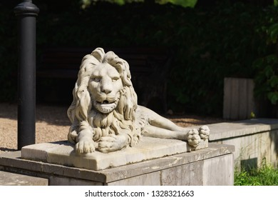 Koreiz, Yalta, Crimea, Russia-September 13, 2018: Sculpture of a marble lion lying in front of the main entrance to the Yusupov Palace, built in the XIX century by architect Krasnov. Sunny summer day