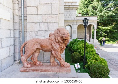 """Koreiz, Yalta, Crimea, Russia-September 13, 2018: Terracotta lion by architect A. Moriji near the entrance to the Yusupov Palace. The inscription in Russian """" it is forbidden to Touch the sculpture"""""""