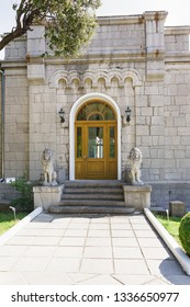Koreiz, Yalta, Crimea, Russia-September 13, 2018: One of several entrances to Stalin's apartment in Yusupov Palace. At the door are the Venetian marble lions