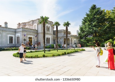 Koreiz, Yalta, Crimea, Russia-September 13, 2018: Tourist group waiting for the guide on the square of three palm trees in front of the entrance to the Yusupov Palace
