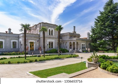 Koreiz, Yalta, Crimea, Russia-September 13, 2018: three palm trees Square at the main entrance to the Palace of Prince Yusupov. Open for tourist visiting historical object on a Sunny summer day
