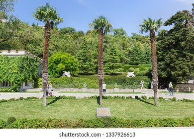 Koreiz, Yalta, Crimea, Russia-September 13, 2018: three palm trees Square opposite the entrance to the Yusupov Palace. Crimean tourist attraction