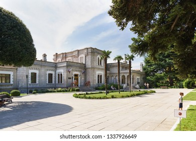 Koreiz, Yalta, Crimea, Russia-September 13, 2018: the Area of three palm trees at the entrance to the Palace of Prince Yusupov. Open for tourist visiting historical object