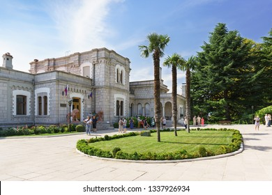 Koreiz, Yalta, Crimea, Russia-September 13, 2018: Excursion group on the square of three palm trees opposite the entrance to the Yusupov Palace. Crimean tourist attraction
