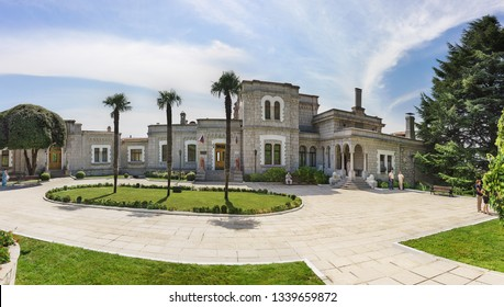 Koreiz, Yalta, Crimea, Russia-September 13, 2018: Panoramic view of the three palm trees square and the facade of the Yusupov Palace, built in the XIX century by architect Krasnov. Sunny summer day