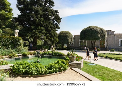 Koreiz, Yalta, Crimea, Russia-September 13, 2018: a Decorative pond and a sculpture of A boy with a fish at the main entrance to the Palace of Prince Yusupov. Sunny summer day