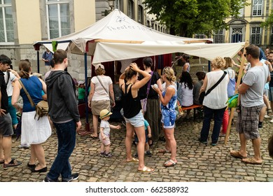 KORNELIMUENSTER, GERMANY, JUNE 18, 2017 - People browse the historic fair of Kornelimuenster. The fair is held annually in the historic old town of Kornelimuenster near Aachen for four days.