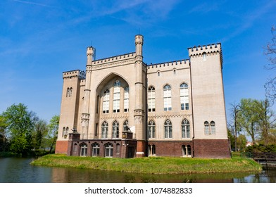 Kornik, Poland - April 21, 2018: Old castle surrounded by a pond by the Aboretum park on a warm spring day