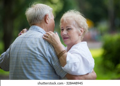 KOROLEV, MOSCOW REGION, RUSSIA - SUMMER, 2015: Smiling couple of old men and woman are dancing waltz at open-air event at the city of Korolev, Moscow region, Russia, Summer, 2015