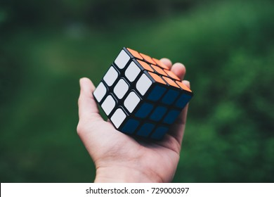 Koronadal City, PH – August 25, 2017: Rubik's Cube was invented in 1974 by Hungarian sculptor and professor of architecture Erno Rubik. Size 3 cube on left palm. Personal perspective. Selective focus.