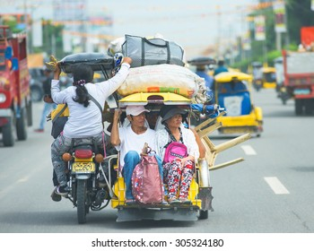 Koronadal City, The Philippines - August 6, 2015: Throughout The Philippines, the tricycle is a popular way of transportation, used for bringing children to school as well as journeys with luggage.