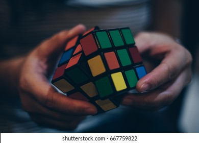 KORONADAL, PHILIPPINES – JANUARY 28, 2017: Rubik's Cube was invented in 1974 by Hungarian sculptor and professor of architecture Erno Rubik. Trying to solve the puzzle.