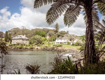 Kororipo Pa site in Kerikeri Basin with historic Stone Store, Mission House, Kemp House, River and Inlet in Far North District, Northland, New Zealand, NZ - framed by punga tree fern