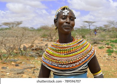 Korr, Marsabit Conty, Kenya - October 2017. Beautiful African young woman from traditional tribe in Kenya is posing for portrait. Traditional beaded decorations in Kenya.