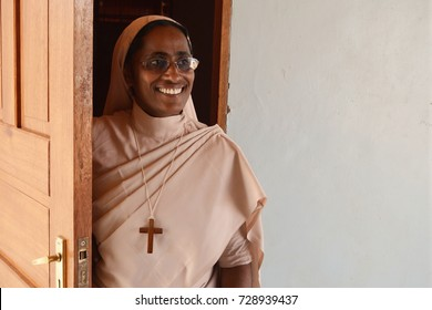 Korr, North Kenya, January 2016. Indian missionary nun smiling and standing in a door. Cross on a neck. Religious habit. Catholic missions in Africa.