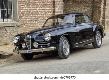 KORSCHENBROICH, GERMANY AUGUST 2014: OLD NOSTALGIC ALFA ROMEO GIULIETTA FROM 1969 PARKING IN FRONT OF AN OLD FARM BUILDING