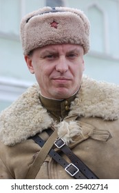 KORSUN, UKRAINE - FEB. 20: A member of the history club called Red Star wears a historical soviet uniform as he participates in a WWII reenactment. February 20, 2009 in Korsun, Ukraine.