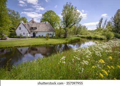 Kortenhoef, Noord-Holland / The Netherlands â?? May 15, 2015: Despite May 2015 being a cold month, there were some warm days. This typical Dutch farm basks in the spring sun during one of the hot days.