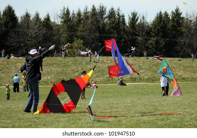 KORTRIGHT CENTER � MAY 06: Man with kite Four Winds Spring Kite Festival in May 06 2012 in Kortright Center in Ontario, Canada. Annual international  festival features participants and viewers.