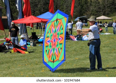 KORTRIGHT CENTER � MAY 06: Man with colorful kite at  Four Winds Spring Kite Festival in May 06, 2012 in Kortright Center in Ontario, Canada.
