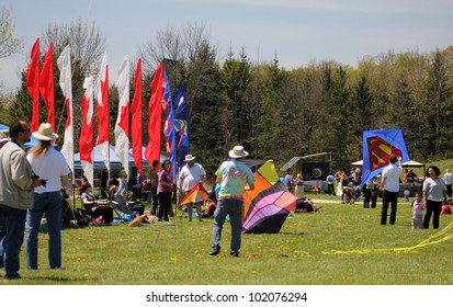 KORTRIGHT CENTER  MAY 06:  Participants and viewers at Four Winds Spring Kite Festival in May 06 2012 in Kortright Center in Ontario, Canada.