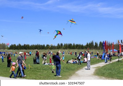 KORTRIGHT CENTER � MAY 06: People at  Four Winds Spring Kite Festival in May 06 2012 in Kortright Center in Ontario, Canada. Annual international  festival features many participants and  viewers.
