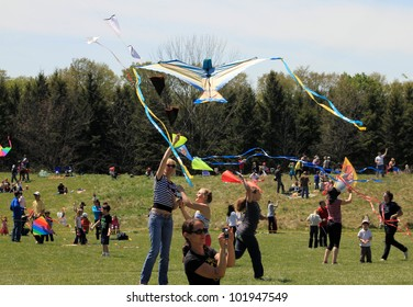 KORTRIGHT CENTER � MAY 06:  Woman with bird shaped kite at Four Winds Spring Kite Festival in May 06 2012 in Kortright Center in Ontario, Canada.